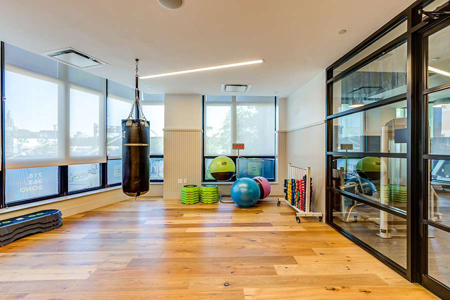 363 Bond Street gym with equipment, heavy punching bag, and scenic views