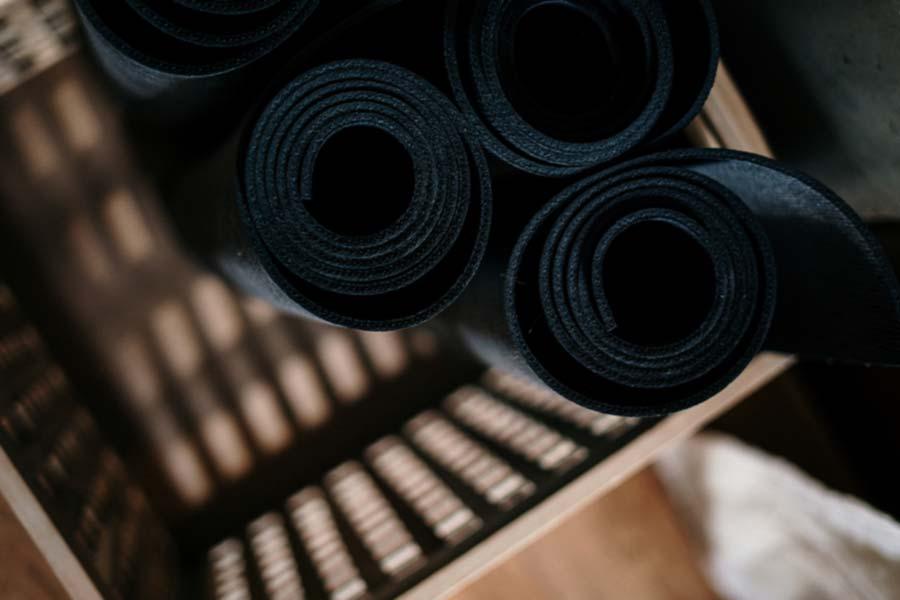 Wicker basket holding yoga mats