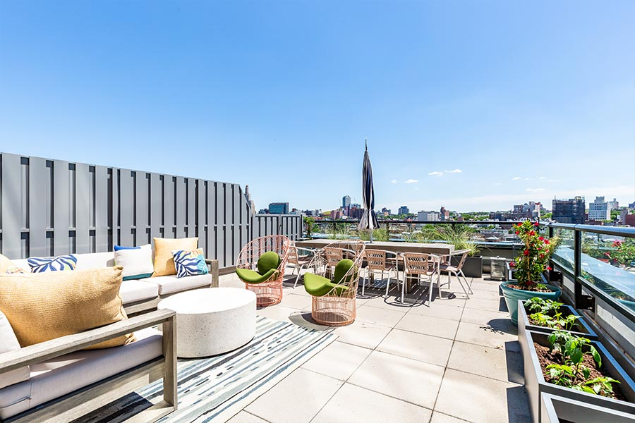 Views of the NYC skyline from the 363 Bond Street Apartments rooftop