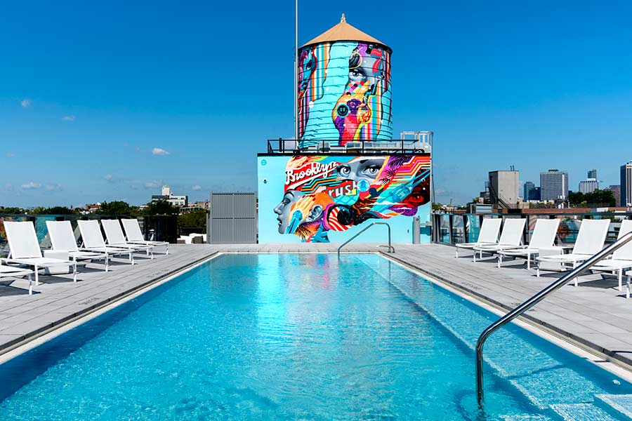 Brooklyn Crush pool and water tower with mural by Tristan Eaton